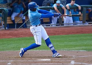 Jorge Soler of the Kansas City Royals displays a balanced and powerful swing during a Major League Baseball game.