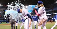 Cavan Biggio of the Toronto Blue Jays receives a Gatorade bath from teammate Vladimir Guerrero Jr. after the Blue Jays big victory.